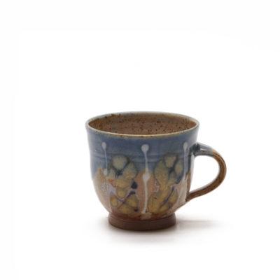 Milchkaffeetasse mit bunter Glasur