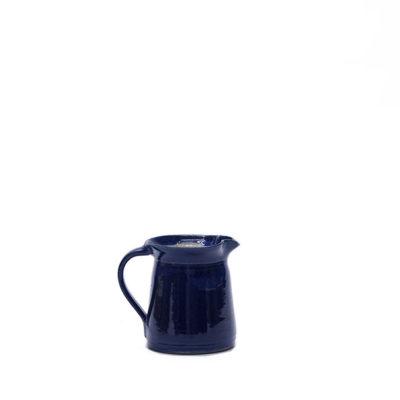 Krug mit blauer Glasur