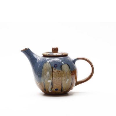 Teekanne mit bunter Glasur